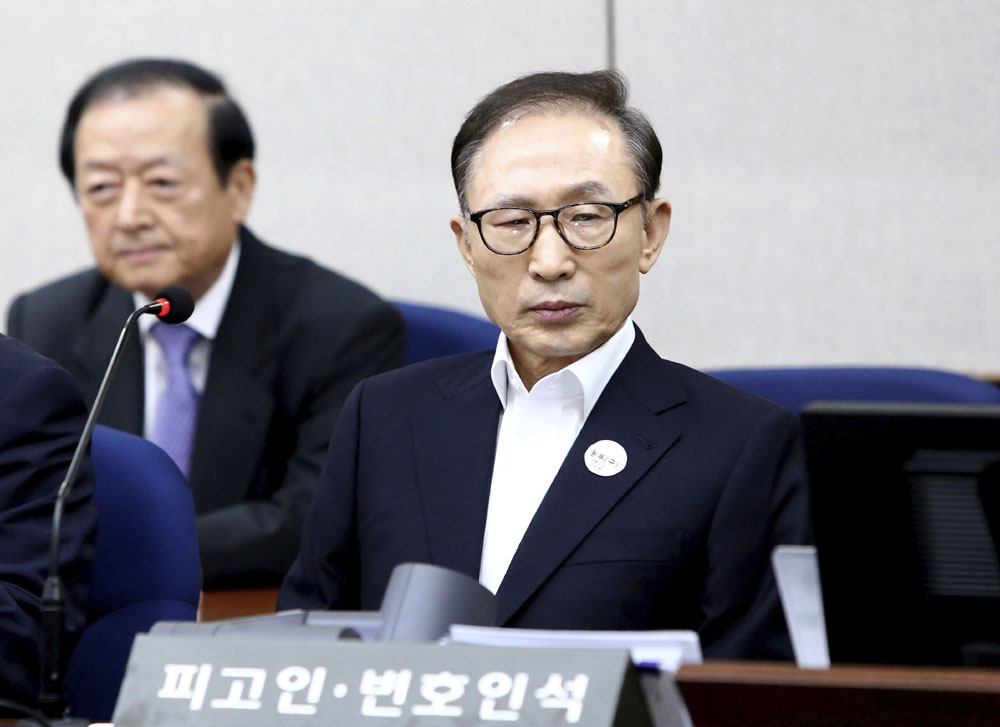 Ex-S.Korean president Lee appears at first trial over corruption charges