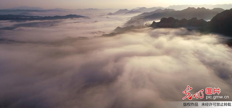 Amazing scenery of sea of clouds at village in Beijing