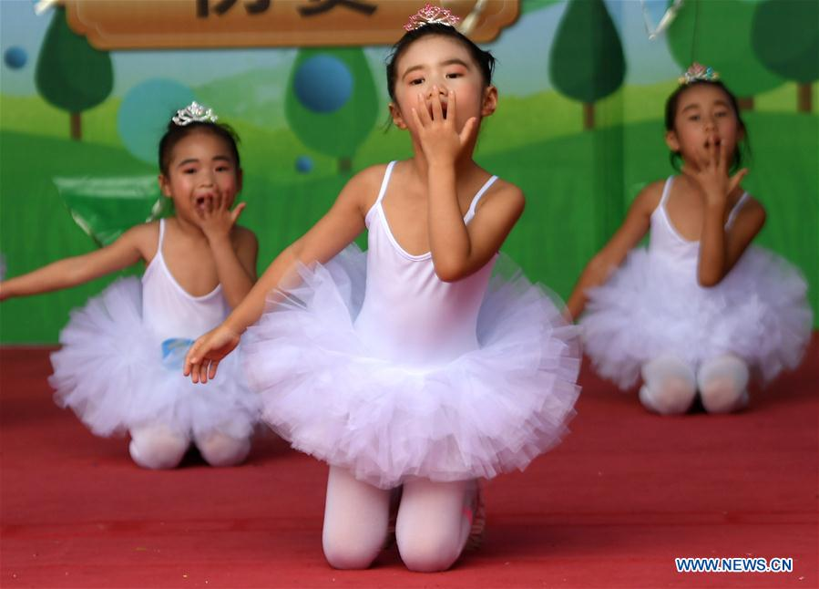 Children perform dance to greet Int'l Children's Day in Qinzhou, south China's Guangxi
