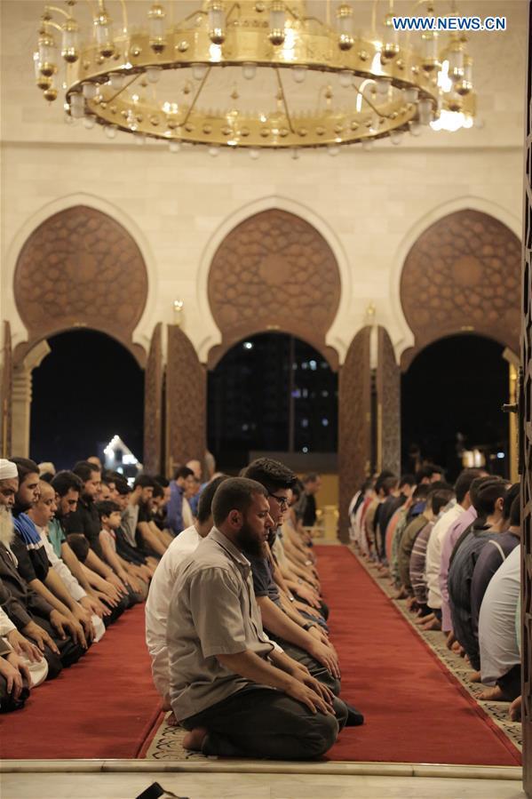Palestinian Muslims perform Tarawih prayer during Ramadan in Gaza City