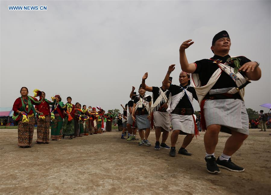 People from ethnic Magar community perform at Bhumi Puja festival at Tundikhel in Nepal