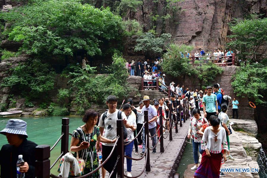 Tourists visit Yuntai Mountain scenic area in China's Henan