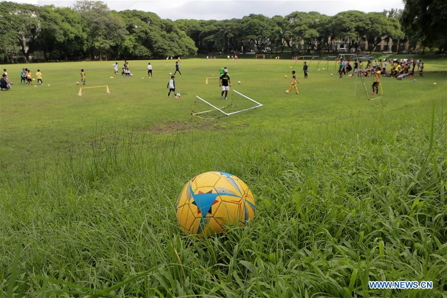 In pics: children play football in Quezon, Philippines