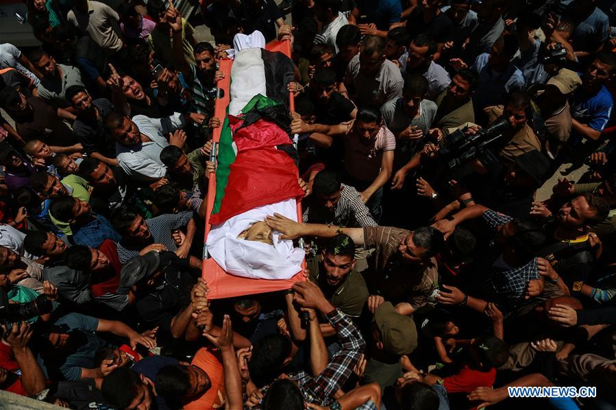 Funeral of Palestinian boy killed by Israeli troops held in Gaza Strip