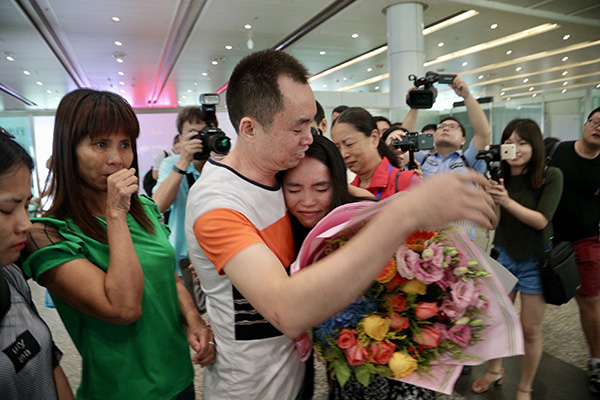 Woman reunites with family after 13 years