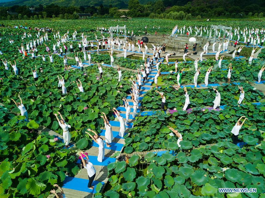 Yoga fans take part in yoga show during tourist activity in SE China's Fujian