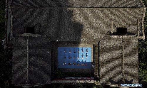 Children practise martial arts at Wenzhou Wushu Museum, east China's Zhejiang