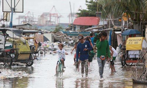Tropical depression Henry hits Manila, Philippines