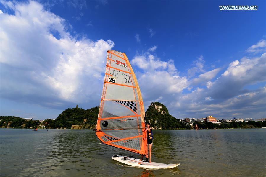 Tourists enjoy themselves in Liuzhou, south China's Guangxi