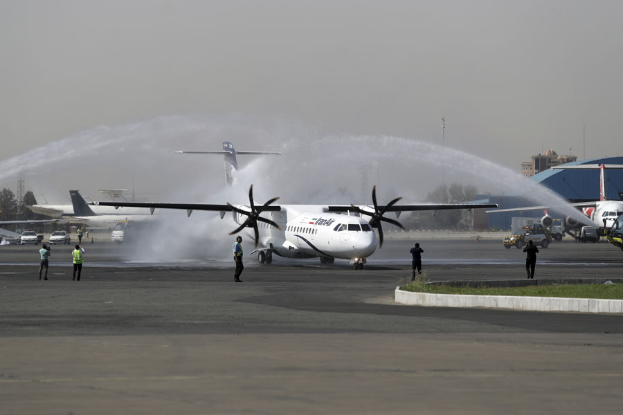 In this photo provided by Tasnim News Agency, a traditional water cannon salute welcomes an Iran Air's new commercial aircraft at Mehrabad airport in Tehran, Iran, Sunday, Aug. 5, 2018. Iran has acquired five new ATR72-600 airplanes from ATR, jointly owned by European consortium Airbus and Italy's Leonardo, a day before the U.S. begins restoring sanctions suspended under the 2015 nuclear deal. [Photo: Mohammad Hassanzadeh/Tasnim News Agency via AP]