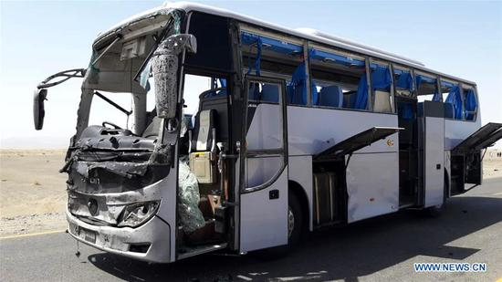 A damaged bus is seen at the site of a suicide blast in Pakistan's southwestern Balochistan province on Aug. 11, 2018. A suicide attack injured six people including three Chinese workers here on Saturday, the Chinese Embassy to Pakistan said. (Xinhua/Stringer)