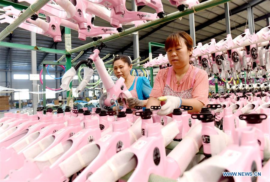 Workers assemble kids' bikes at factory in Guangzong County, N China's Hebei