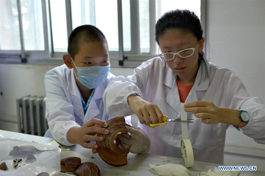 Education activity on cultural relics restoration held at Gansu Museum, NW China