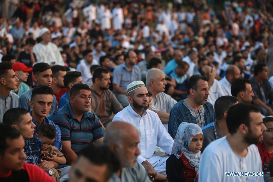 Palestinians attend Eid al-Adha prayers in Gaza City