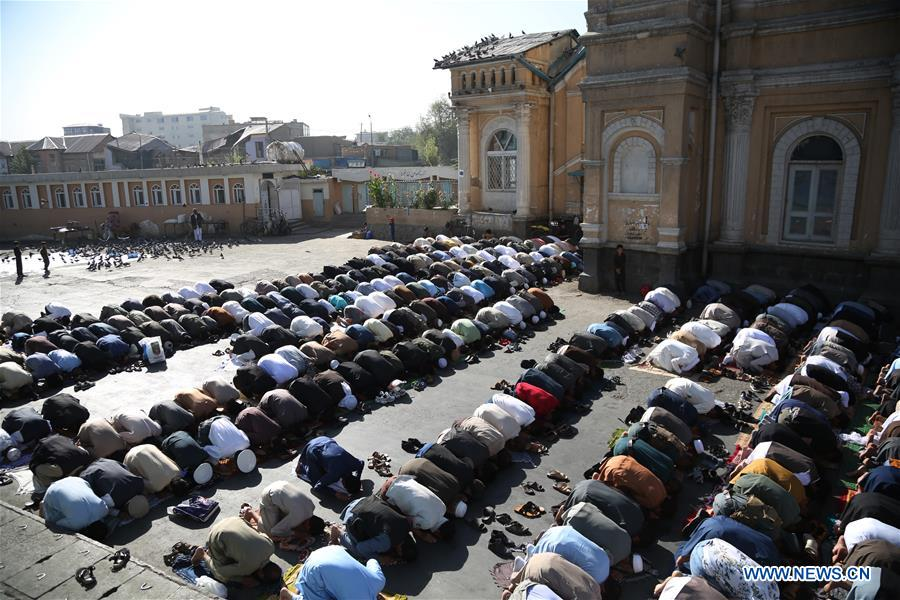 People attend Eid al-Adha prayers in Kabul