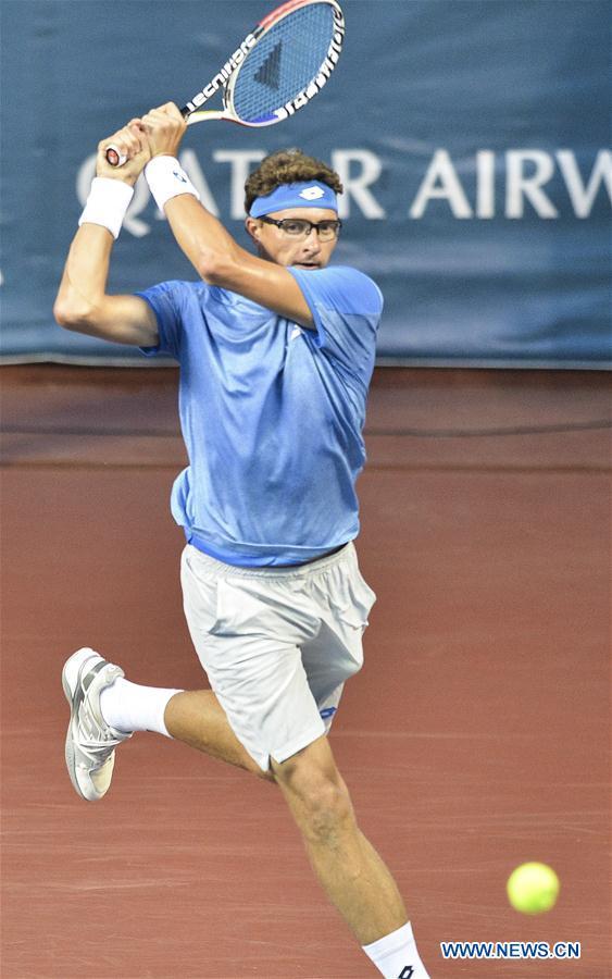 Denis Istomin competes with Prajnesh Gunneswaran during tennis men's single semifinal at Asiad