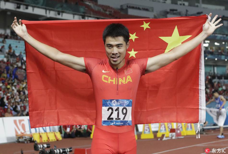 China's Xie Wenjun celebrates after winning the men's 110m hurdles final during the athletics competition at the 18th Asian Games in Jakarta, Indonesia, Tuesday, Aug. 28, 2018.[Photo: Lee Jin-man / IC]