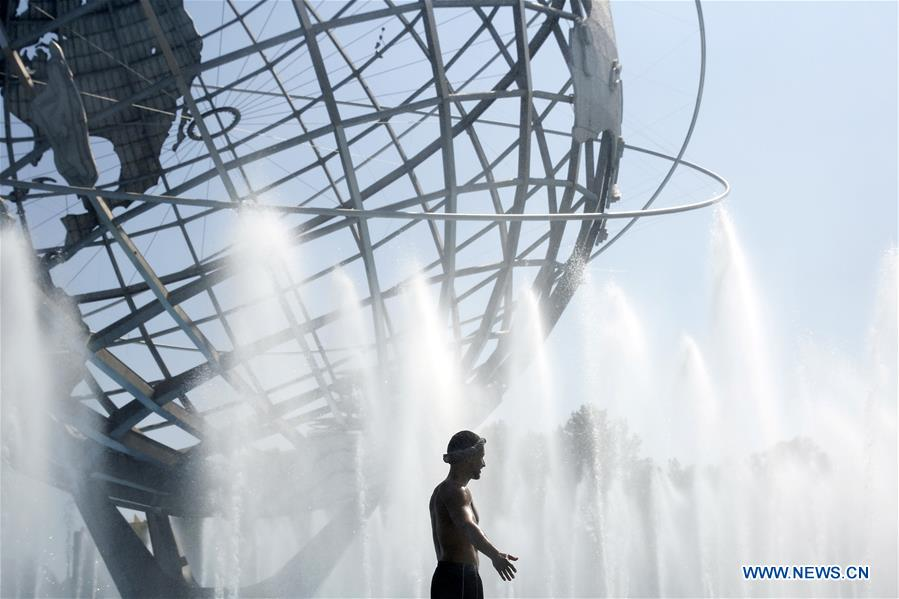 People cool off at Flushing Meadows Corona Park in New York City, U.S.