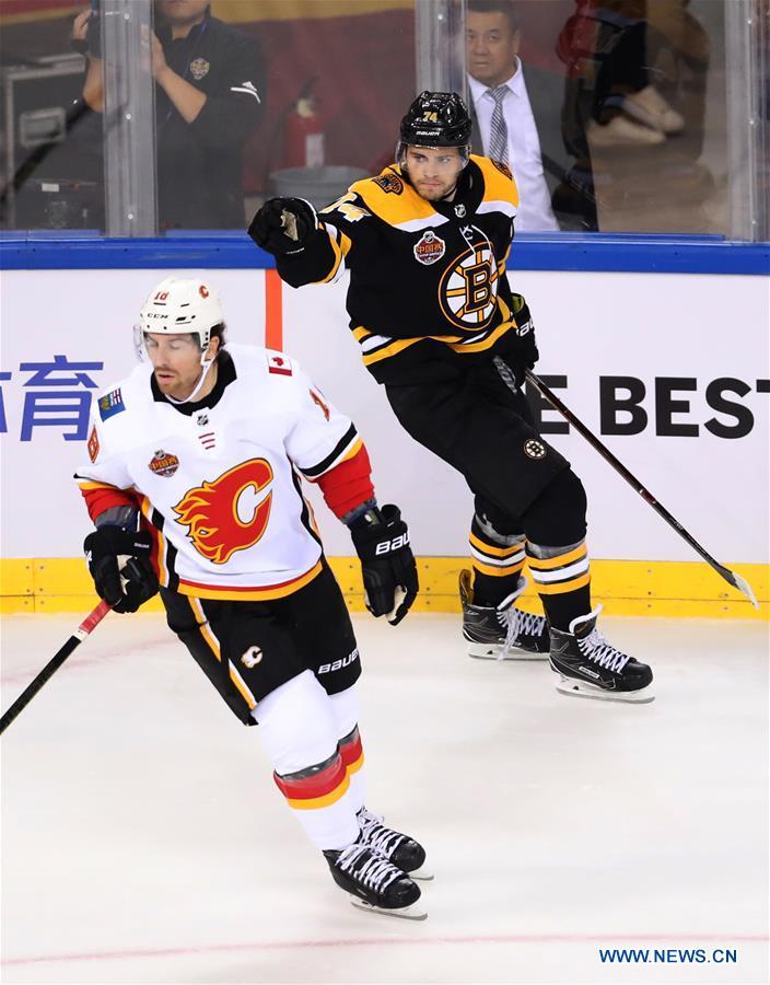 Boston Bruins douse Calgary Flames in Beijing