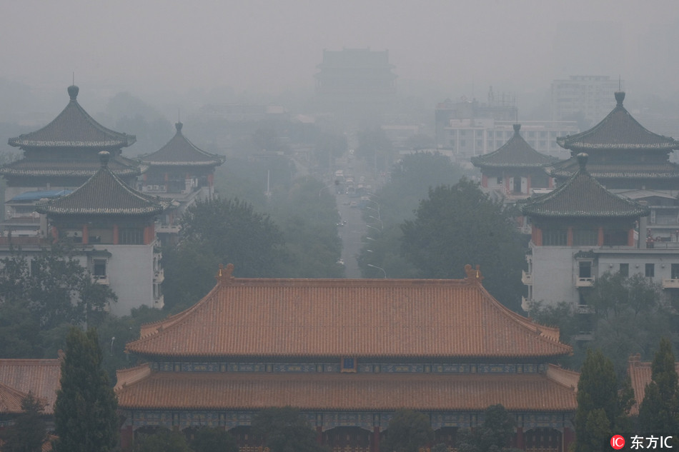 The Palace Museum, also known as the Forbidden City, is seen vaguely in heavy smog in Beijing, China, 15 October 2018. [Photo: IC]