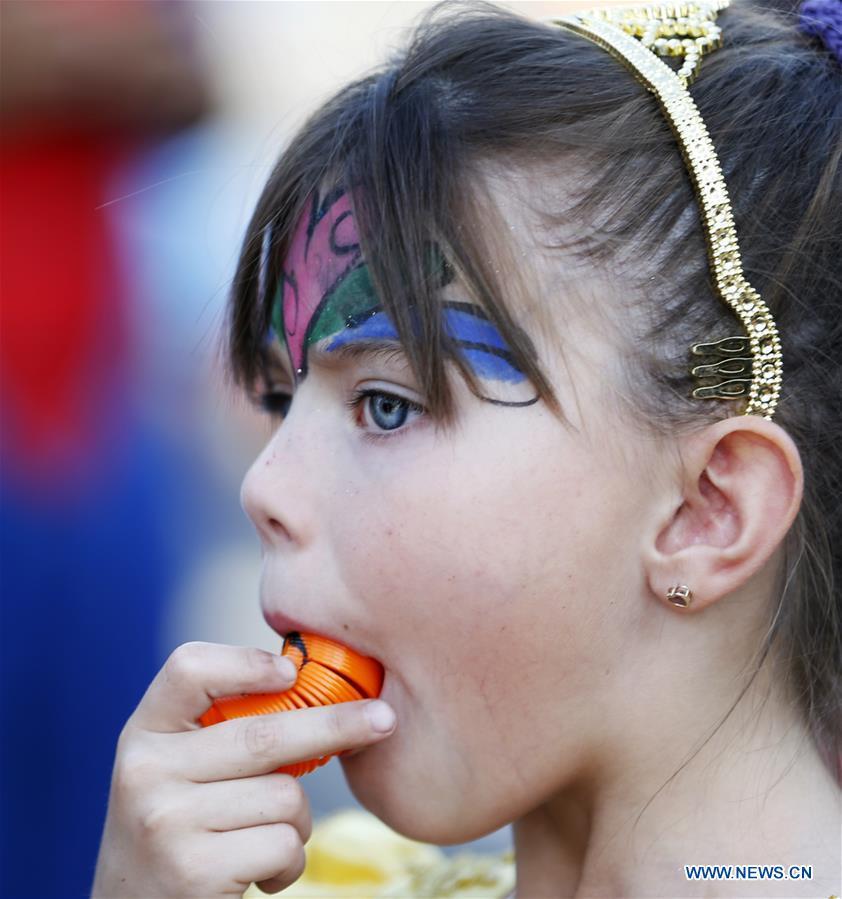 Children attend Halloween parade in Los Angeles