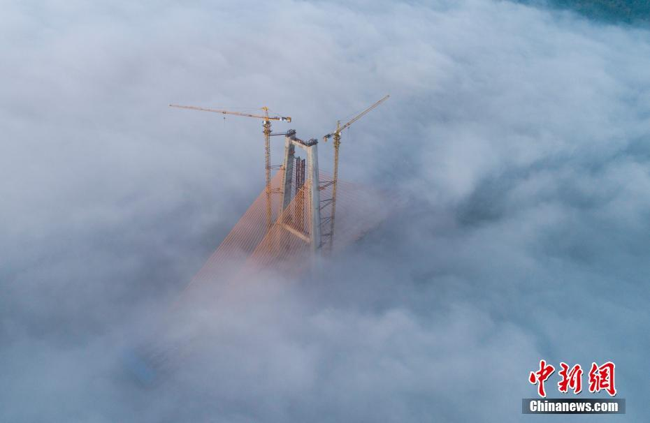 Canal bridge shrouded in mist in Southwest China