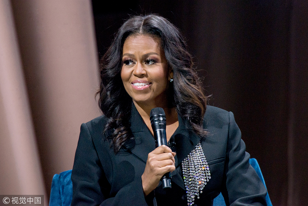 Former First Lady Michelle Obama appears onstage at Becoming: An Intimate Conversation with Michelle Obama at the Capital One Arena in Washington, Saturday, Nov. 17, 2018. She was joined by Valerie Jarrett, a former senior advisor to President Barack Obama. [Photo: Polaris/Erin Scott]