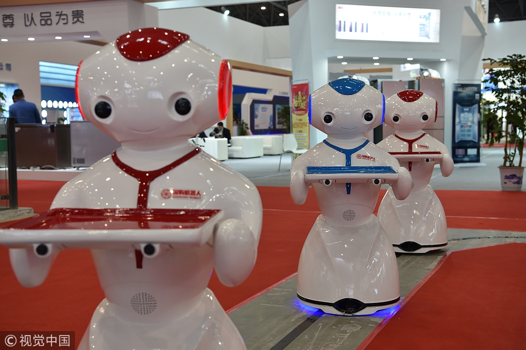 Robots on display at the Appliance and Electronics World Expo in Hefei, Anhui Province, November 16, 2018. [Photo: VCG]