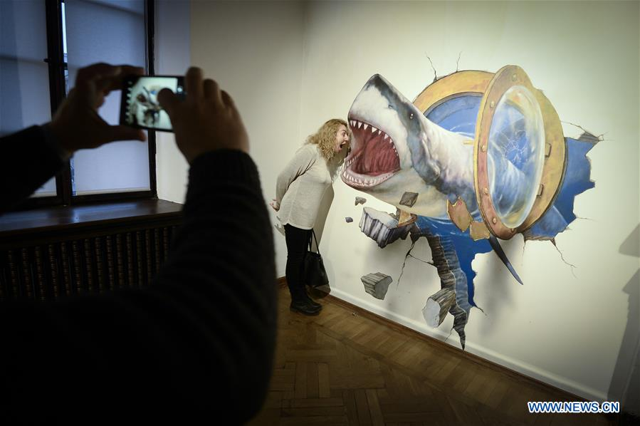 People visit newly built Museum of Illusions in Warsaw, Poland
