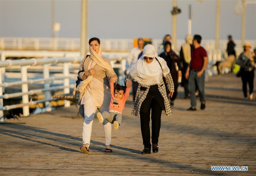 People enjoy leisure time in Kish Island, southern Iran