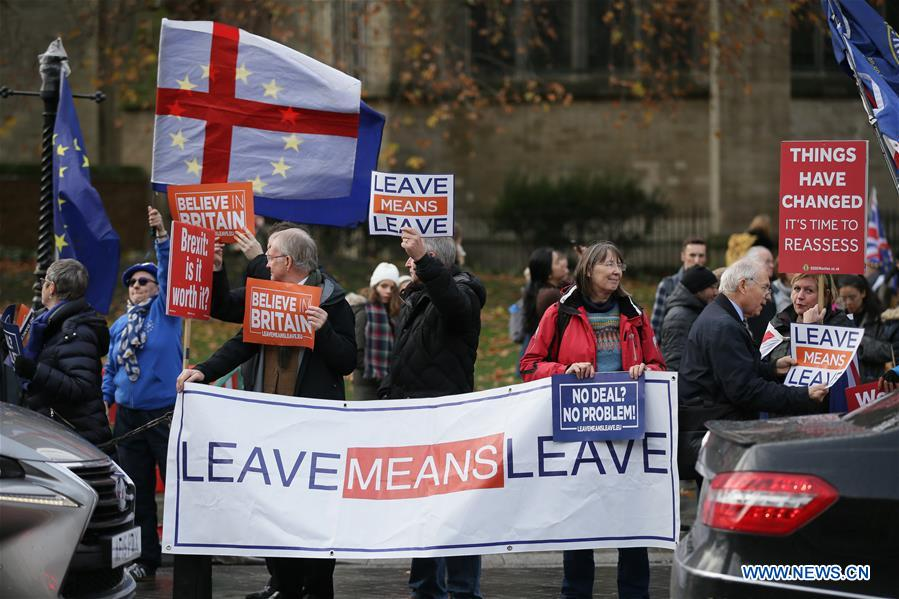 People protest outside Britain's House of Commons in London