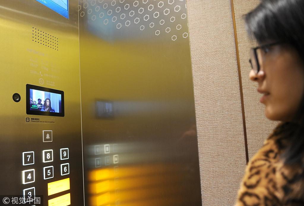 """A guest scans her face to start the elevator at Alibaba's AI-driven """"Flyzoo Hotel"""" in Hangzhou, Zhejiang Province, December 17, 2018. [Photo: VCG]"""
