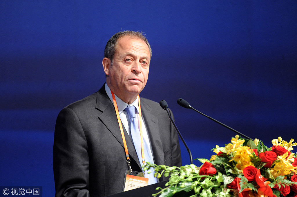 Stephen Perry, the president of 48 Group Club, delivers speech at the World Trade Promotion Summit in Beijing, May 15, 2012. [Photo: VCG]