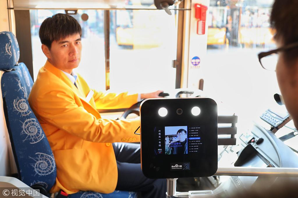 A tourist gets on the bus through facial recognition in Shanghai, December 18, 2018. [Photo: VCG]