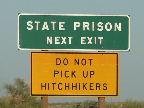 Sign in Iowa warns drivers not to pick up hitchhikers.[Photo: wikimedia commons]