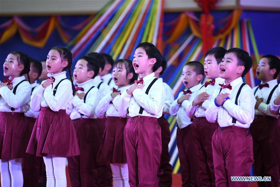 Pupils perform to celebrate upcoming New Year's Day in Hefei
