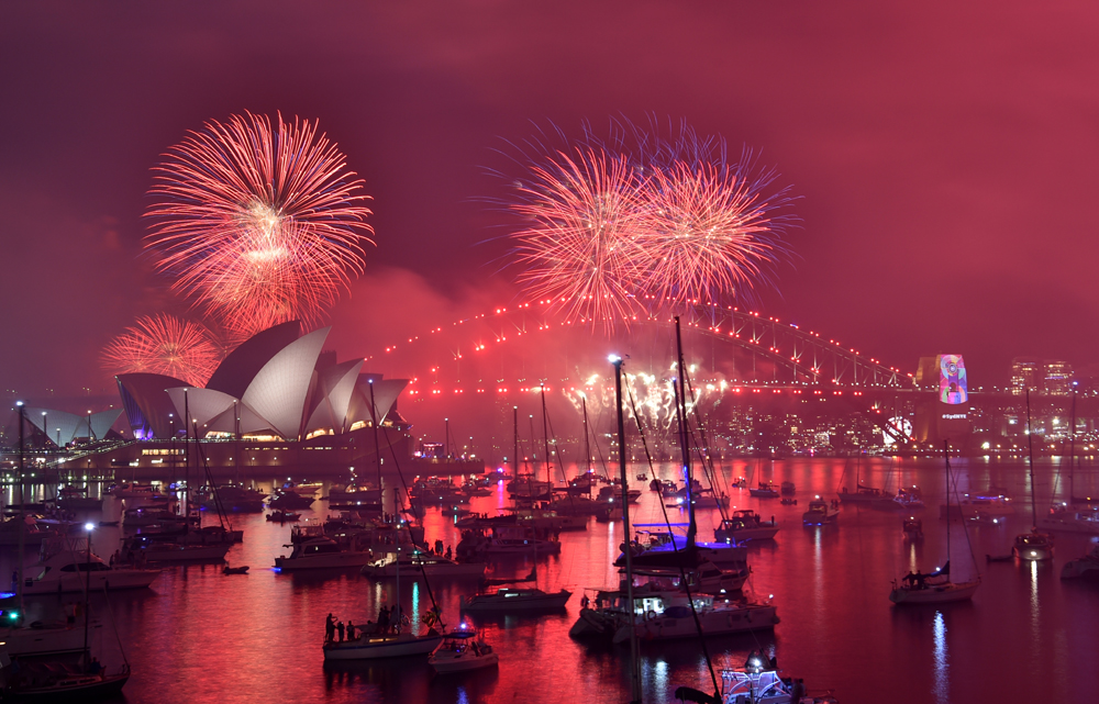 Sydney New Year fireworks light up the harbor