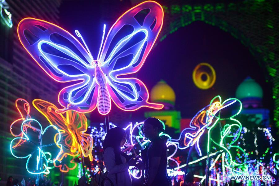 People visit Light and Motion Putrajaya Festival in Putrajaya, Malaysia