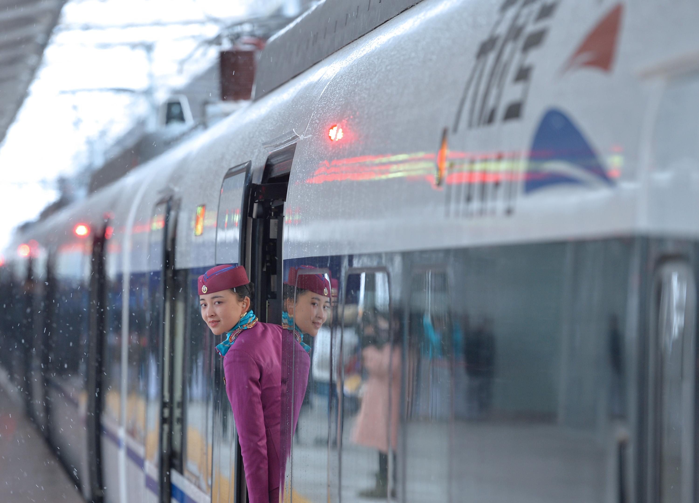 "A train attendant inside the ""Tianfu"" bullet train on Tuesday, December 29, 2018. [Photo: IC]"