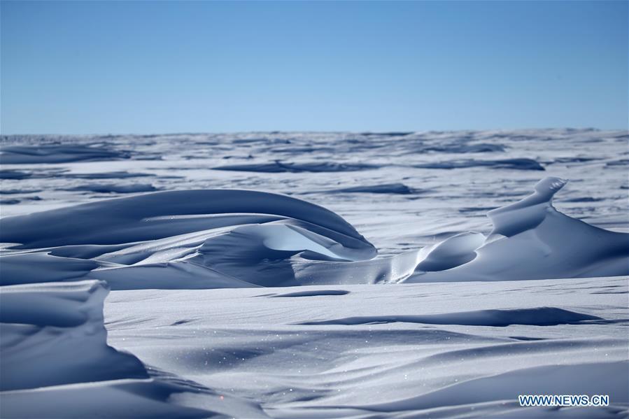 China's 35th Antarctic expedition team runs through ice knolls in Antarctica