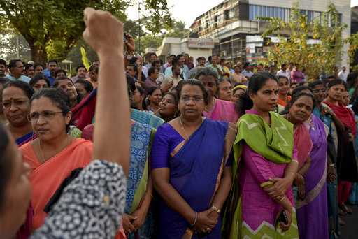 "A woman shouts slogans against gender discrimination as they gather to form part of a hundreds kilometer long ""women's wall"" in Thiruvananthapuram, in the southern Indian state of Kerala, Tuesday, Jan. 1, 2019. The wall was organized in the backdrop of conservative protestors blocking the entry of women of menstruating age at the Sabarimala temple, one of the world's largest Hindu pilgrimage sites defying a recent ruling from India's top court to let them enter. [Photo: AP]"