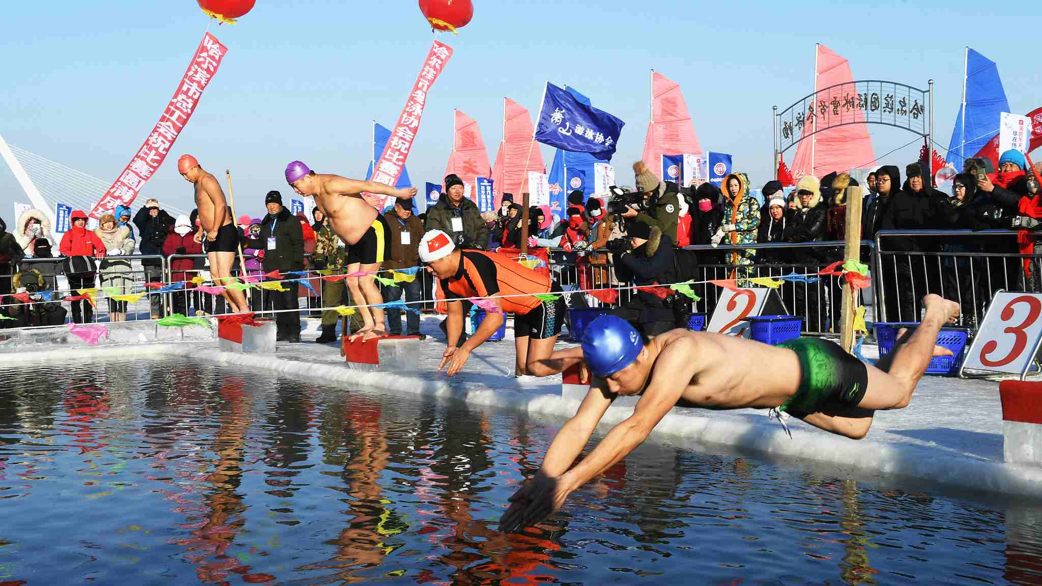 Winter swimming event held in freezing conditions in NE China