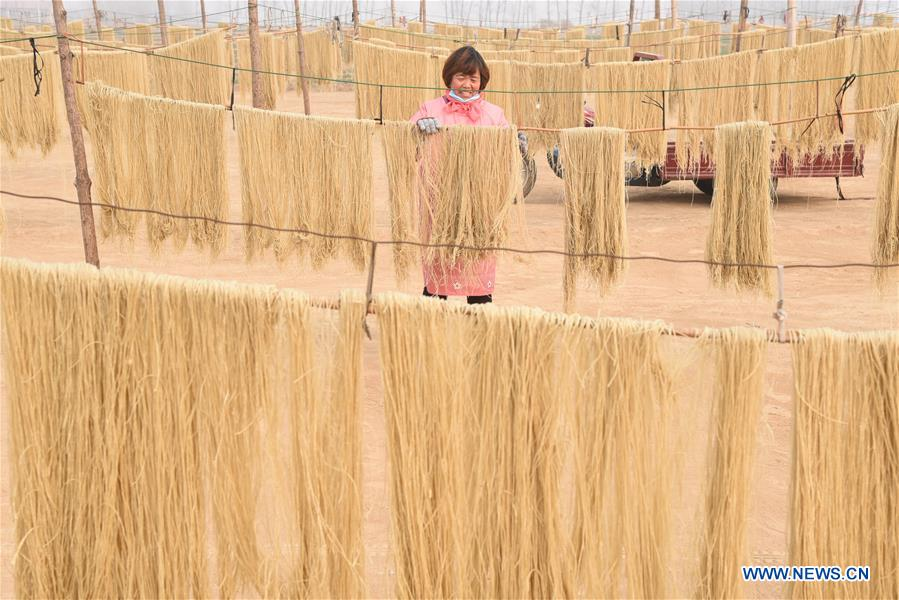 Farmers in China's Shandong process vermicelli to satisfy market demand