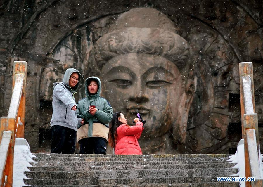 Snow-covered Longmen Grottoes in Luoyang, C China's Henan