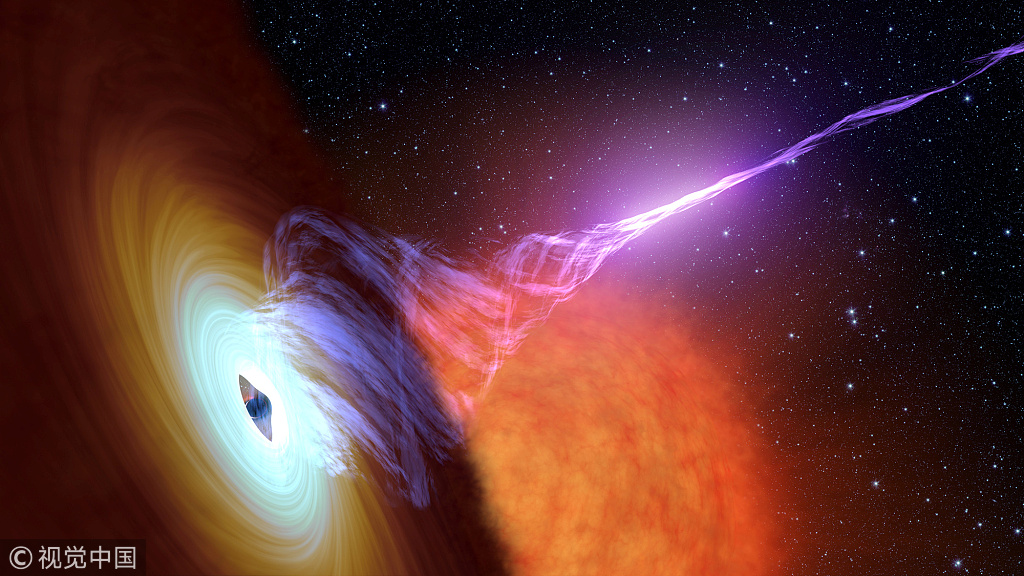 File Photo: This photo released October 30, 2017 shows a black hole with an accretion disk, a flat structure of material orbiting the black hole, and a jet of hot gas, called plasma. [Photo: VXG]