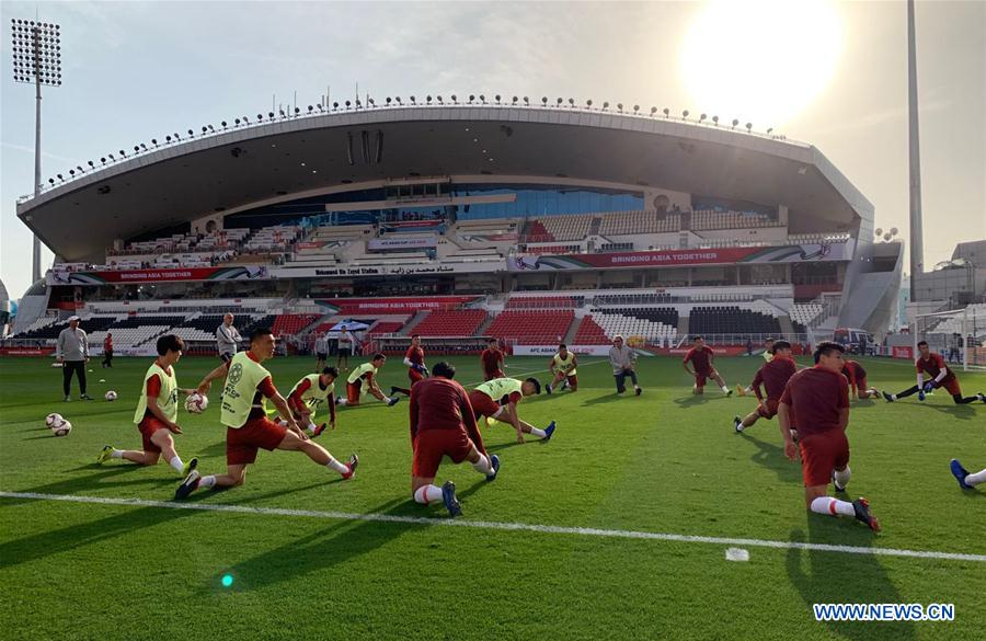 China's football team attends training session before Asian Cup match against Philippines