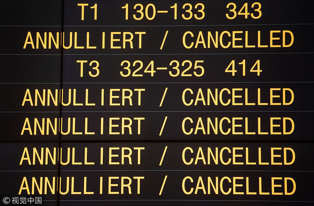 A board displays cancelled flights during a one-day strike by security staff at Stuttgart's airport on January 10, 2019. [Photo: VCG]