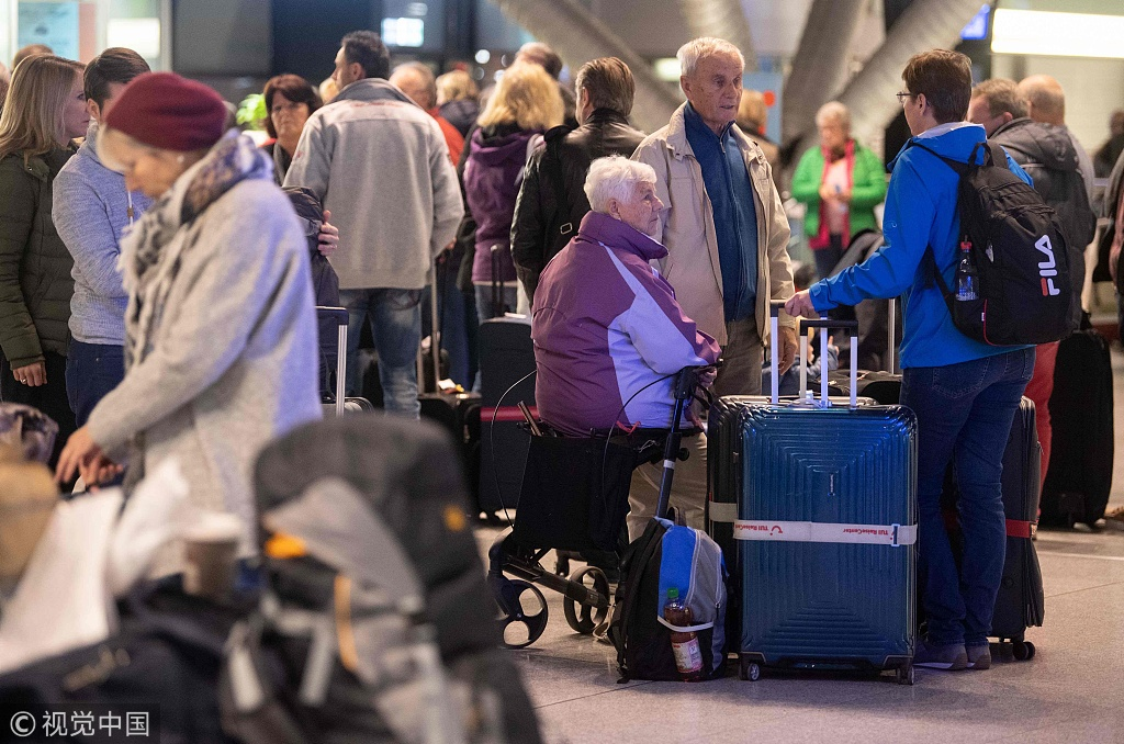 Travellers wait for after flight cancellations during a one-day strike by security staff at Stuttgart's airport on January 10, 2019. [Photo: VCG]