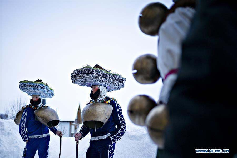 People participate in procession to offer best wishes for New Year in Switzerland