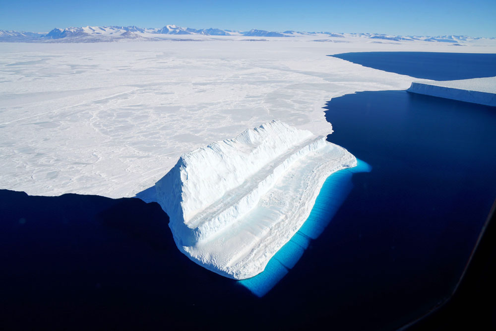 This file NASA image released on December 20, 2017 and acquired on November 29, 2017 by Operation IceBridge during a flight to Victoria Land, shows an iceberg floating in Antarctica's McMurdo Sound. [File photo: NASA/AFP/Chris Larsen]